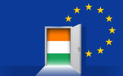 Irish Flag in a door way surrounded by European flag.