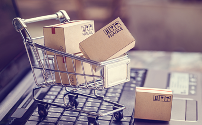 Picture of a Shopping basket with Fragile boxes donating Online Shopping